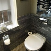 Small WC with panels in 'Gritstone' by Versital. Accessories by Keuco.  Selection available to view at the showroom.