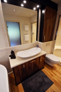 Black walnut bathroom cabinet with surface mounted sink