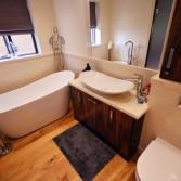 Free standing slipper bath, walnut bathroom cabinet and mirror