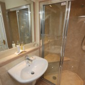 Large shower with seat. Versital shower panels and top in 'Champagne' and 'Almond' edging detail.