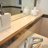 Fabulous attention to detail in the bathroom. Work top and edging dado by 'Versital' in Champagne and Wenge,