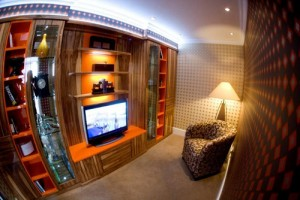 Media room in wallnut and orange high gloss finish.