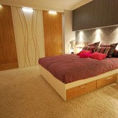 White and oak fitted furniture means that the other colours can be a little more daring with hot pink and silver.