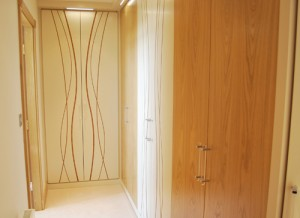 Wardrobes in Oak real wood with cream satin and wavy pattern