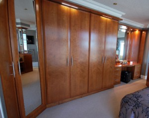 cherry fitted wardrobes and dressing table with spotlight downlights