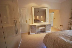 Dresisng table and wardrobes in cream and mocha high gloss