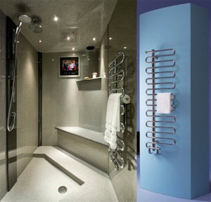 Stainless steal towel radiator from Bisque with white towel.