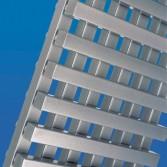 Designer radiator from bisque in brushed aluminium - crossed style.