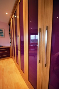 Bright aubergine high gloss with oak surround fitted wardrobes and drawers