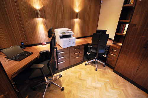 Home office in real wood veneers in black walnut with 2 work stations.