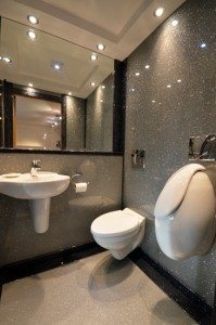 Luxury bathroom in Just Silver sparkle - mirrors keep the bathroom feeling bright.
