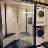 Walk in shower with washer and dryer built in