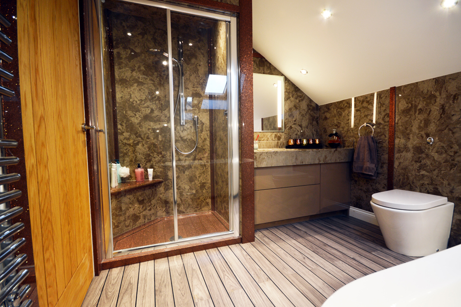 Cream and copper bathroom with shower panels, shower tray and vanity top from Versital