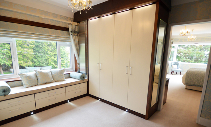 Walk in wardrobe in cream and walnut
