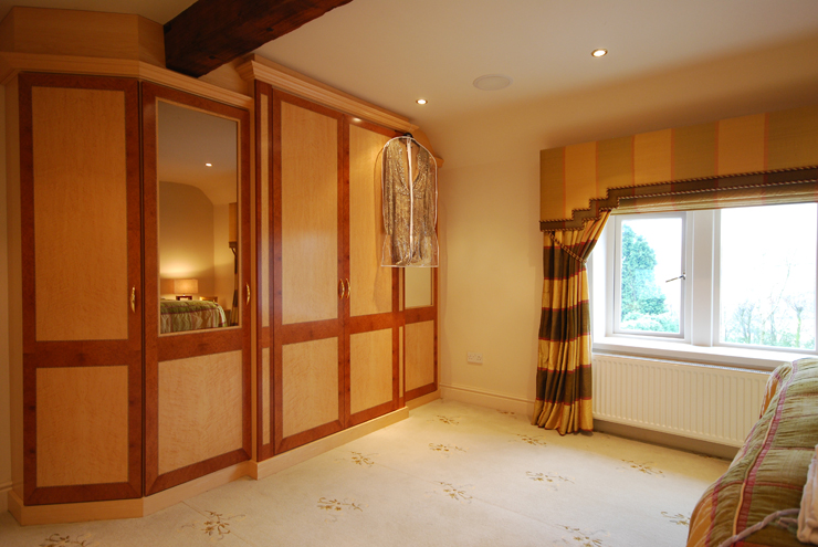 Hand crafted real wood veneers available for beautifully detailed walk in wardrobes