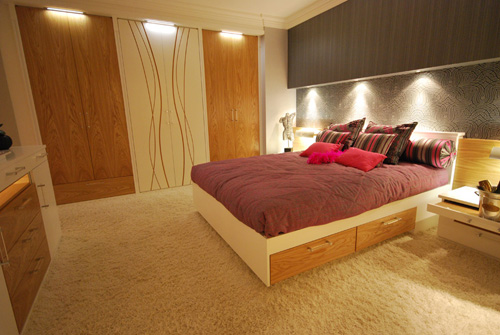 bespoke bedroom furniture with led light in wardrobe and over the bed