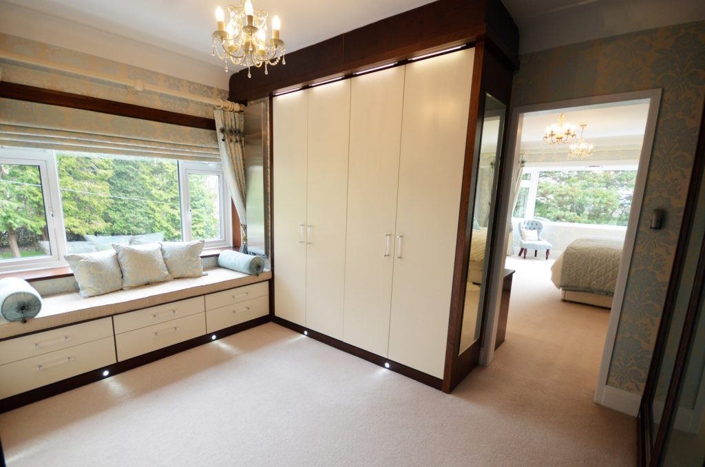 Bespoke walk in wardrobe fitted wardrobes in real wood veneers