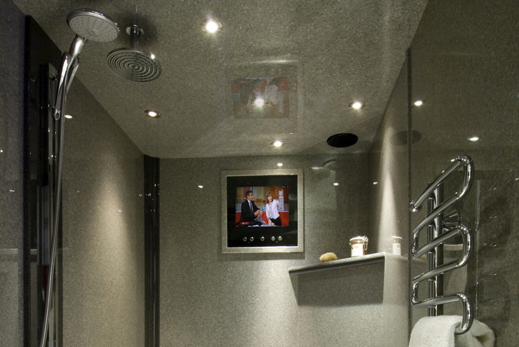 Wet room style grey shower area with walk in shower in granite finish from Langley Interiors Bolton
