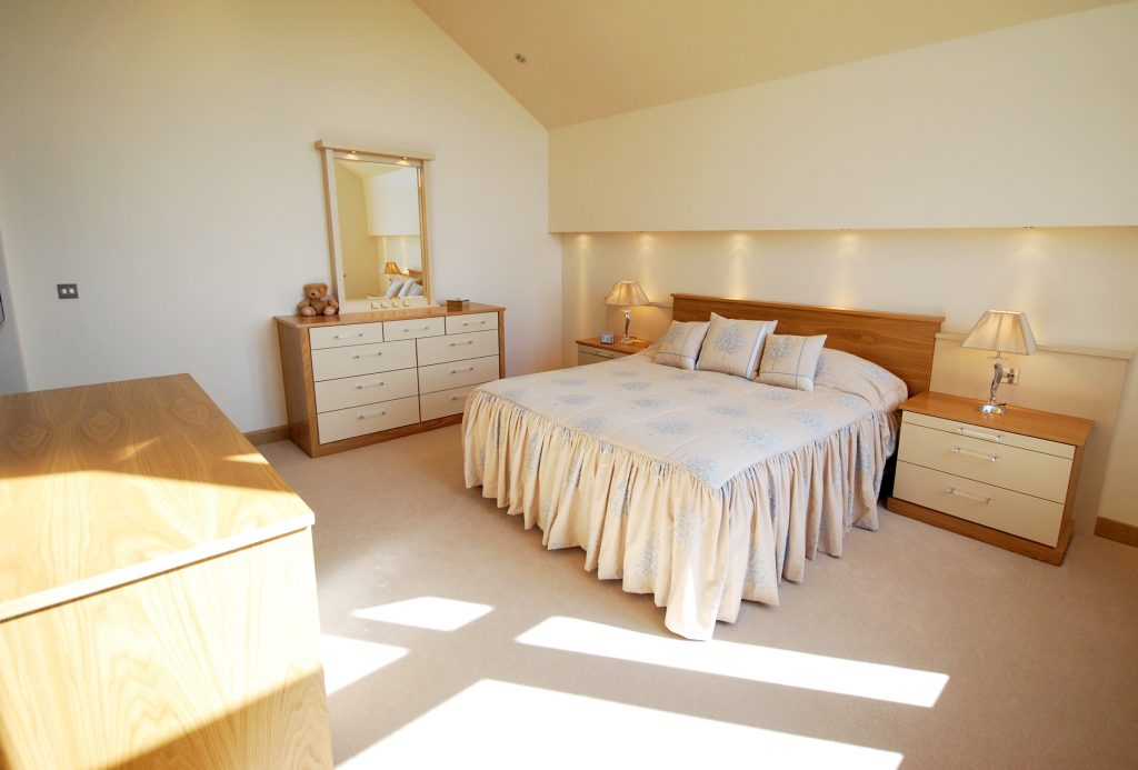 Oak and cream bedroom furniture is a classic combination that never dates.