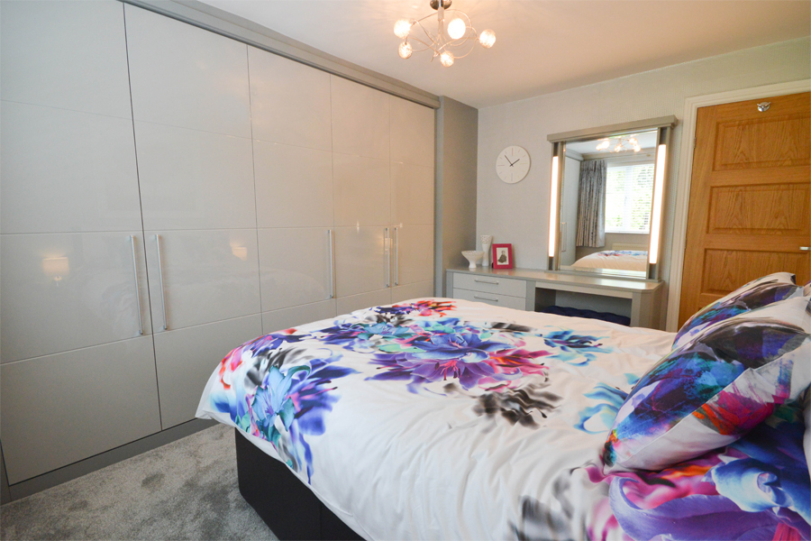 Modern high gloss fitted wardrobes in grey